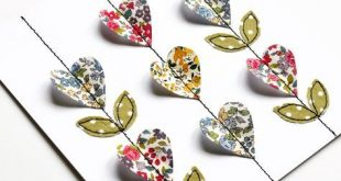 Little fabric hearts and leaves stitched in rows to create a pretty pattern by S...